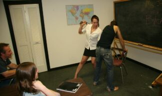 Cheyenne Jewels uses her belt to spank her student in the front of the class