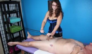 dominatrix ties up a man's cock
