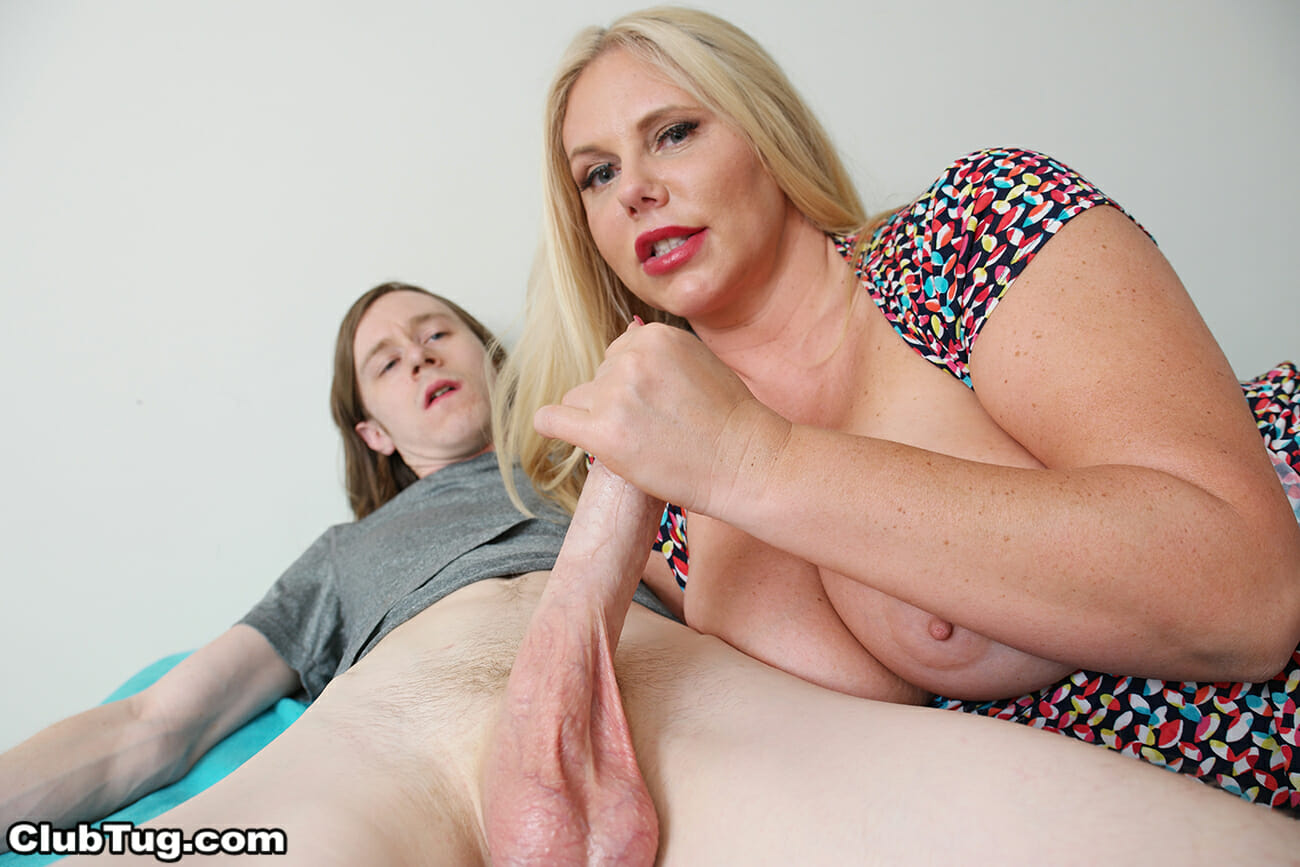 Then the sexy blonde with big tits completely undresses and gives her step  son full unrestricted access to her gigantic boobs. She squeezes them  together as ...