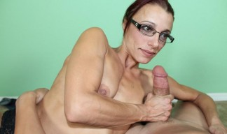 milf in glasses jerking a cock