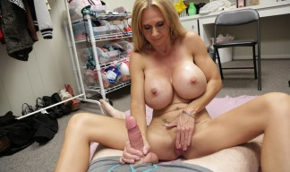 busty MILF masturbates while jerking cock