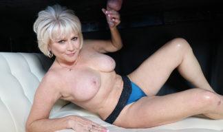 Nikki Sixxx jerking cock at the gloryhole