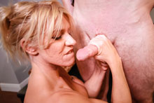 Bossy to the max Busty milf Gina stroking voluminous dick for salary raise.