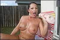 Ct pics 15 Meet the neighborhood milf Margo Sullivan, who loves nothing more than jacking off big huge cocks until they erupt mountains of man goo.