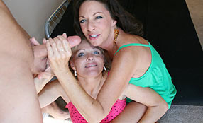 two housewives giving a handjob