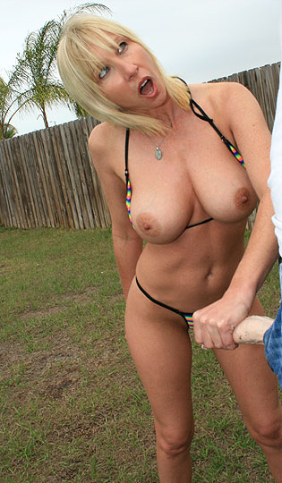 big tit blonde giving handjob in backyard
