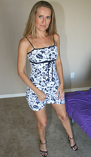 horny milf pulling off her dress
