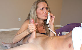 milf giving a handjob while on the phone